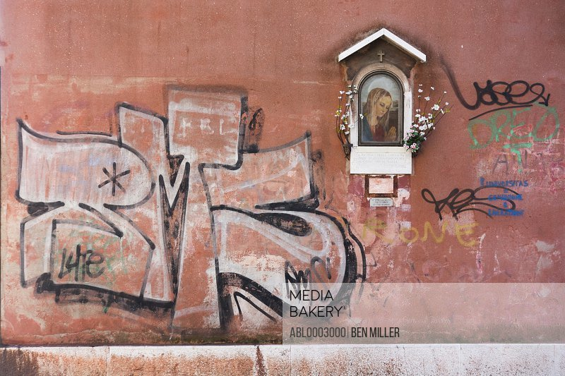 Graffiti on Wall and Icon of Virgin Mary