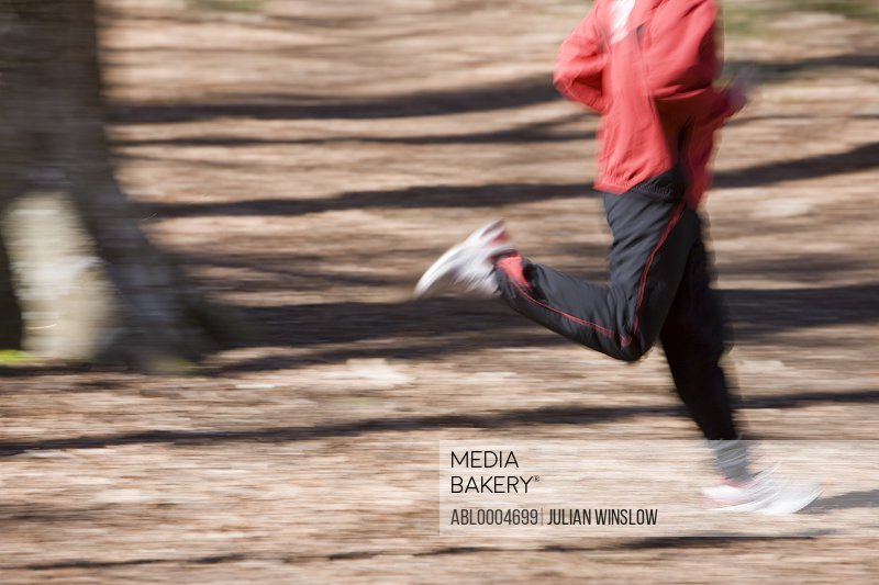 Portrait of man body running in the park