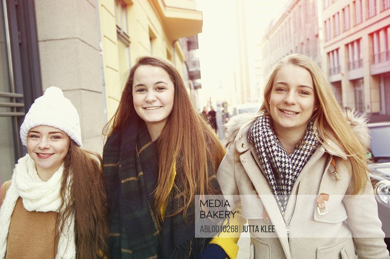 Teenage Girls Walking on City Street