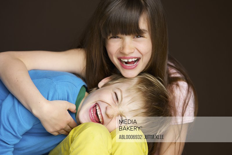 Boy and Girl Hugging and Laughing