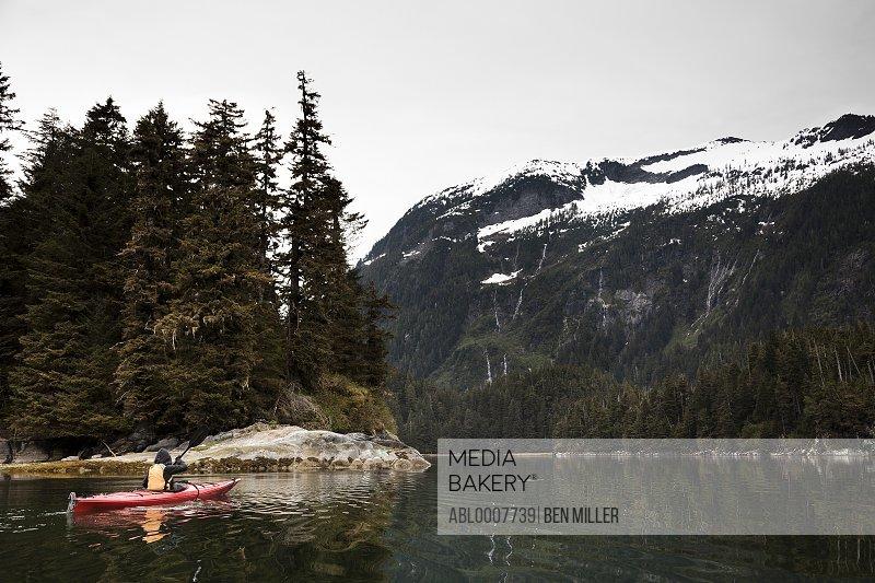 Back View of Woman Kayaking, Chatham Strait, Alaska, USA