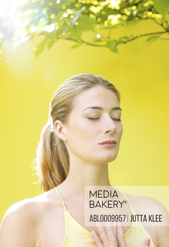 Woman Meditating With Hands Together