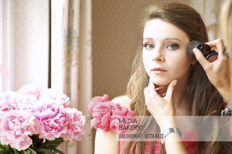 Teenage Girl Having Makeup Applied