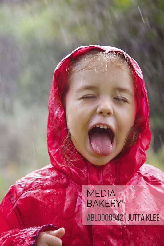 Young Girl with Tongue Sticking Out in the Rain