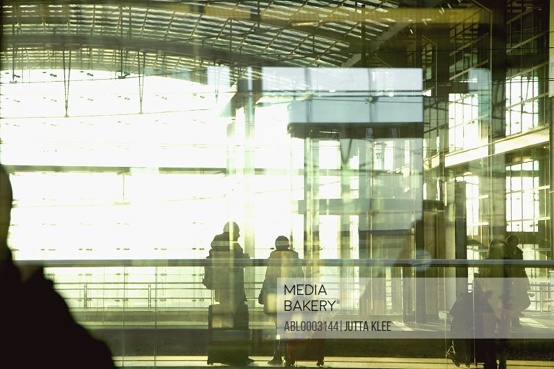 Travellers behind Glass Wall at S-Bahn Station, Berlin, Germany