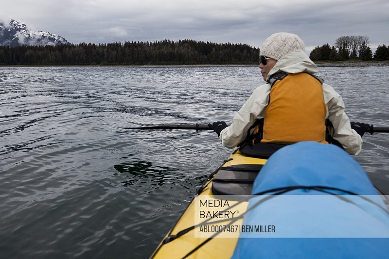 Back View of Woman Kayaking, Chatham Strait, Alaska, USA