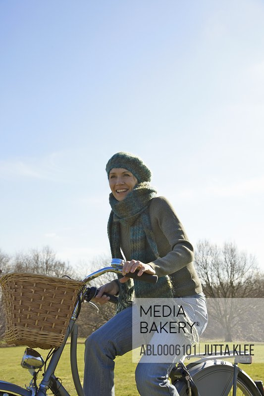 Woman cycling in the countryside