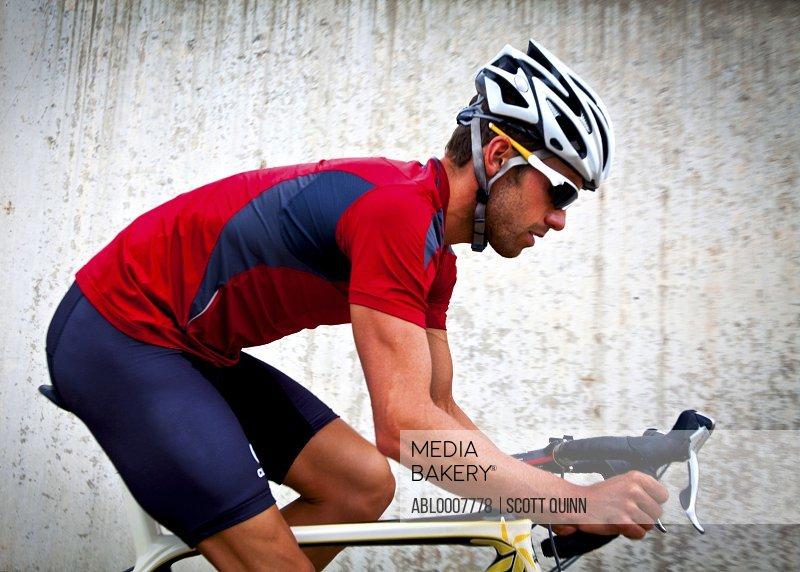 Profile of Cyclist Riding Bike