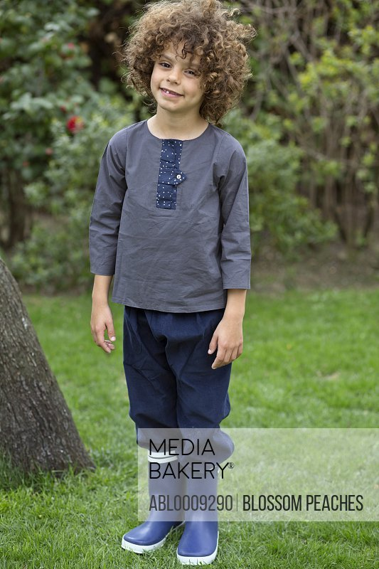 Portrait of Young Boy in Garden