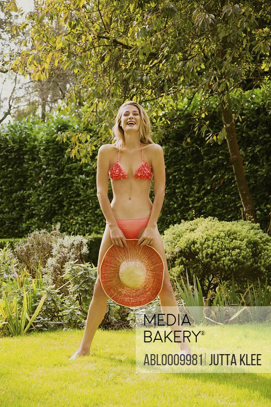 Woman Wearing Bikini Standing in Garden