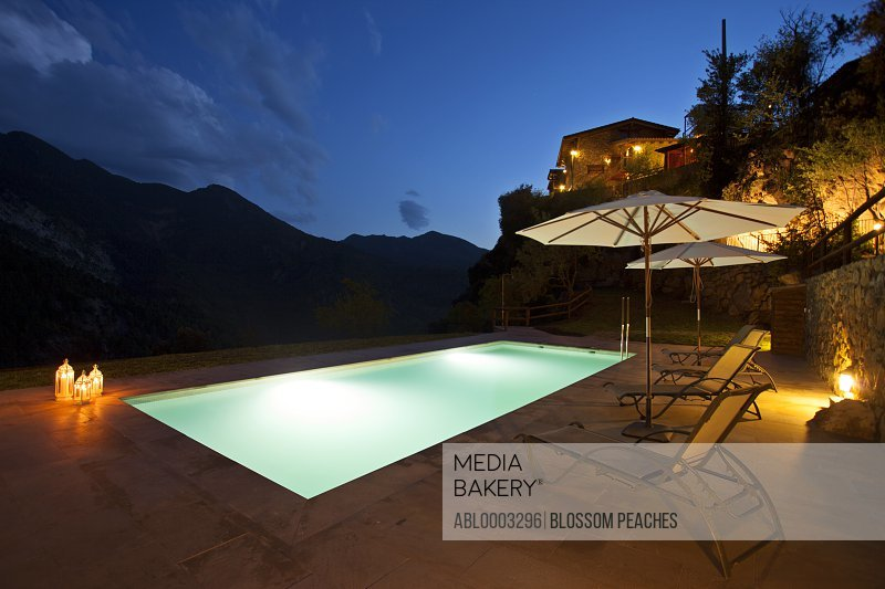 Illuminated Swimming Pool of Country House at Night