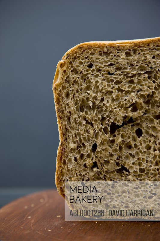 Whole meal loaf of bread on a wooden board