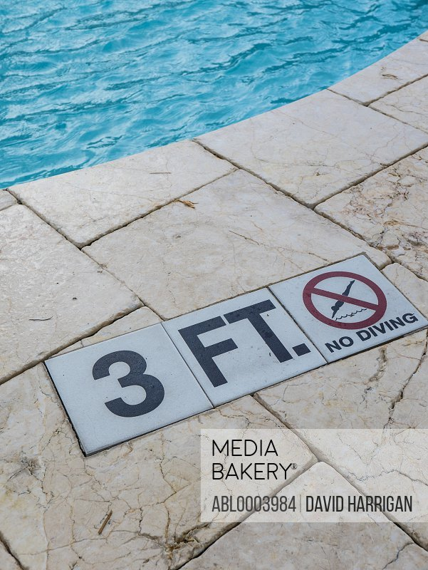 Depth and No Diving Sign on Edge of Swimming Pool