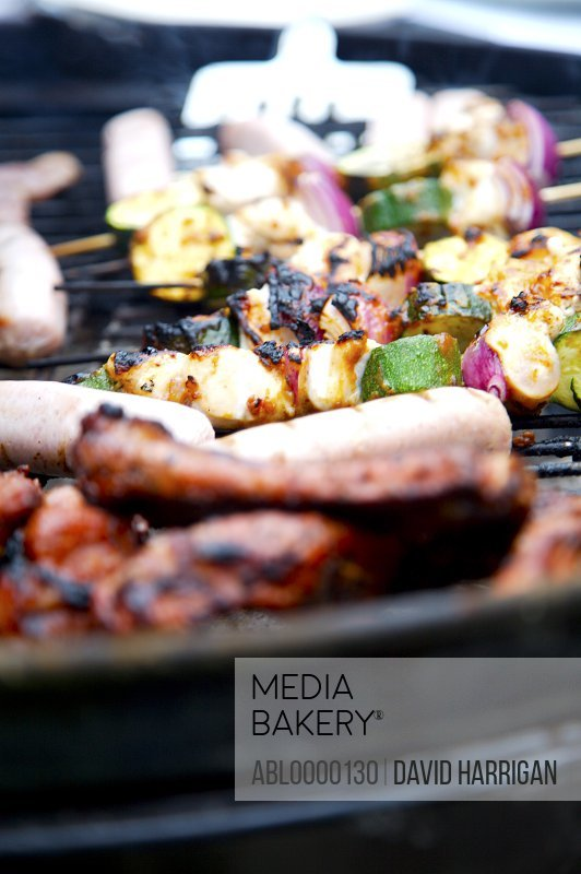 Extreme close up of barbeque grill with vegetables and meats