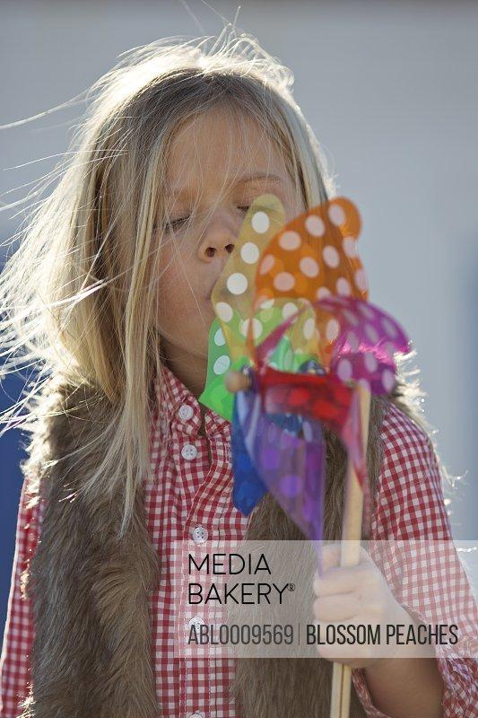 Young Girl Blowing Pinwheel