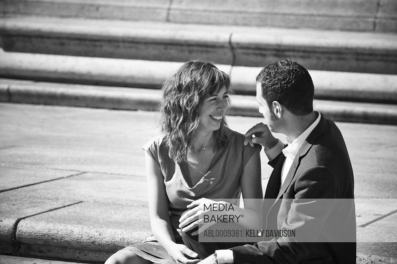 Couple Sitting on Steps in Public Square