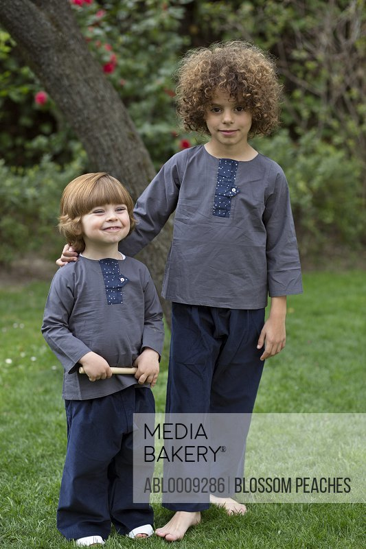 Two Young Boys Standing in Garden