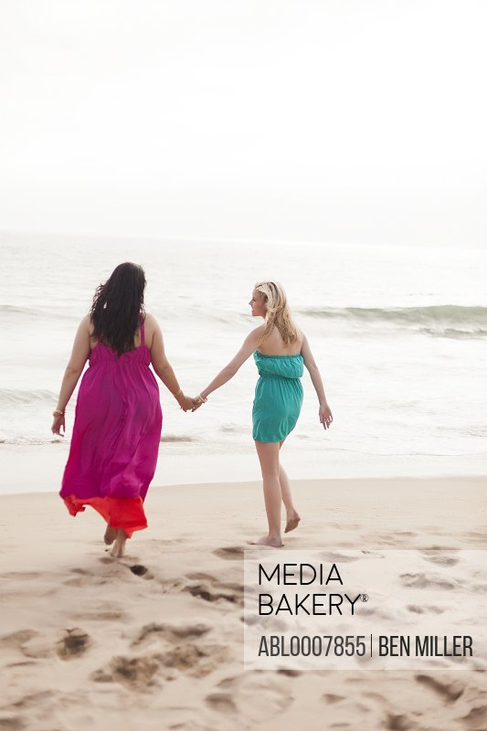 Back View of Two Women Walking on Beach