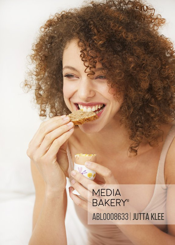 Woman Eating Toast and Soft Boiled Egg