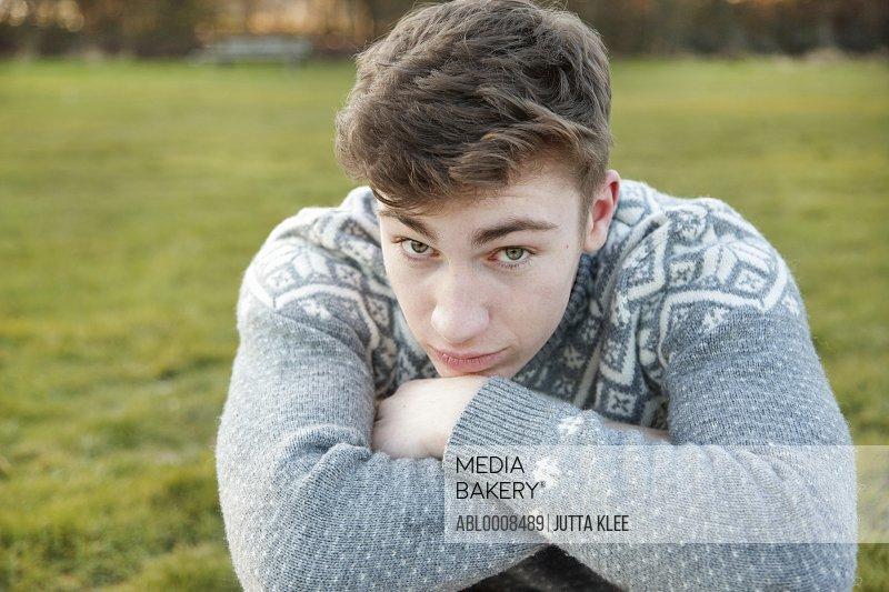 Teenage Boy Resting Chin on Arms
