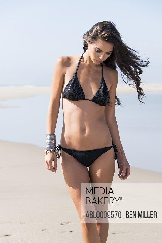 Woman Wearing Black Bikini Walking on Beach
