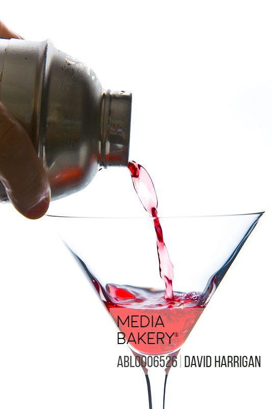 Pouring Cocktail in Martini Glass