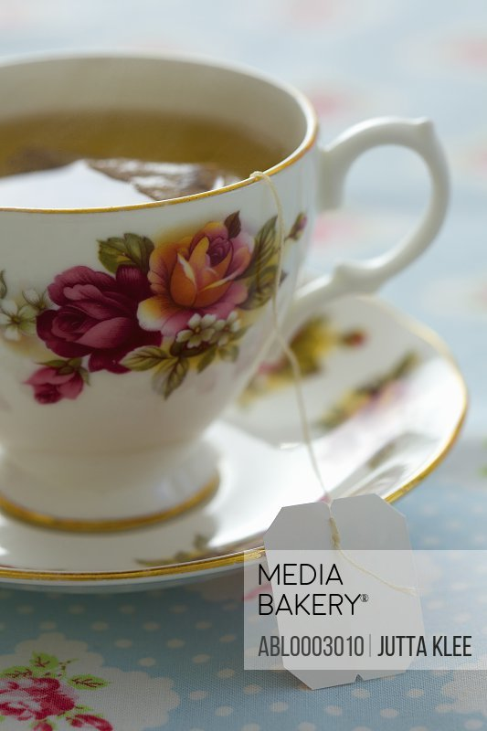 Floral Pattern Tea Cup with Green Tea