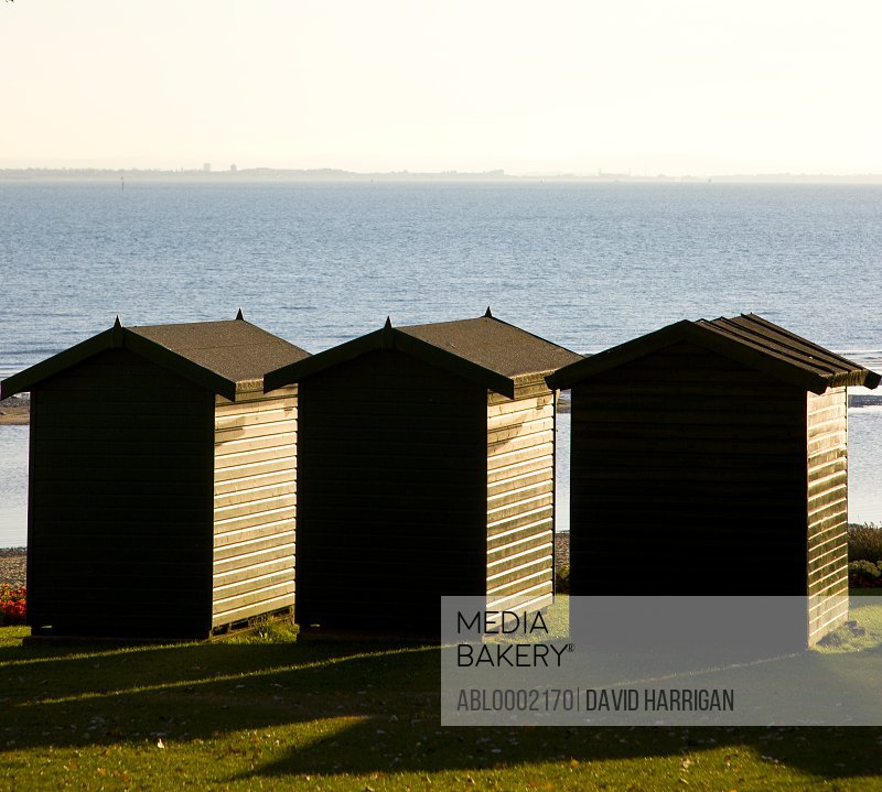 Back View of Three Beach Huts Facing the Ocean