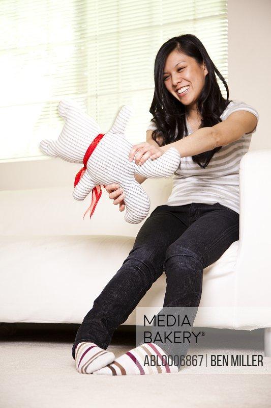 Teenage Girl Playing with Stuffed Toy