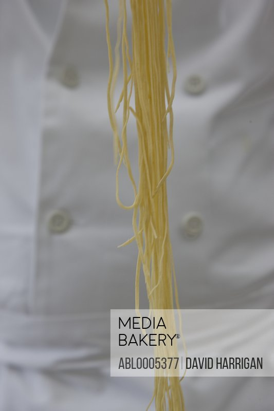 Chef holding angel hair pasta - headless