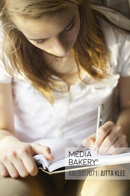 Teenage Girl Writing