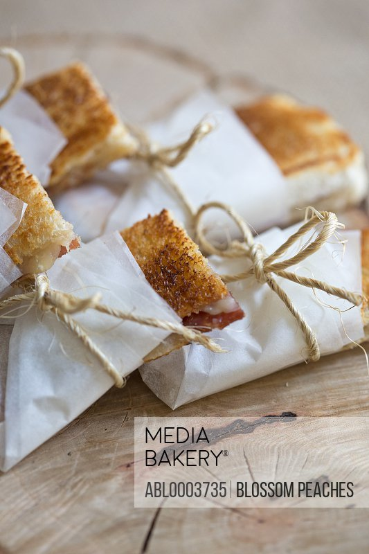 Mini Sandwiches Wrapped in Paper and Tied up with Strings