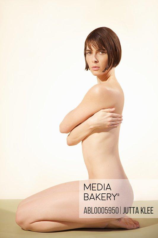 Profile of a nude woman kneeling