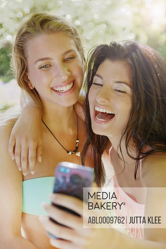 Two Young Women Taking Selfie Laughing