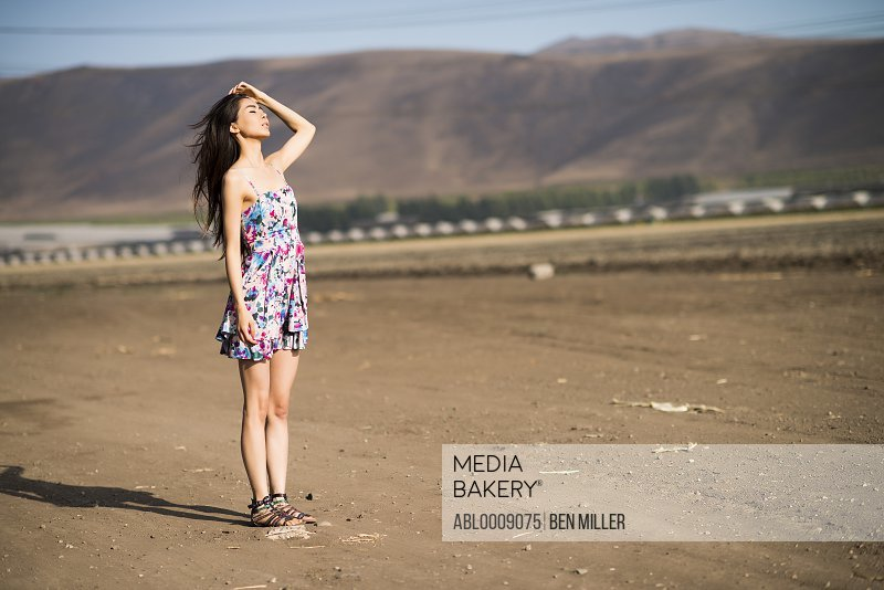 Woman Standing on Dry Field