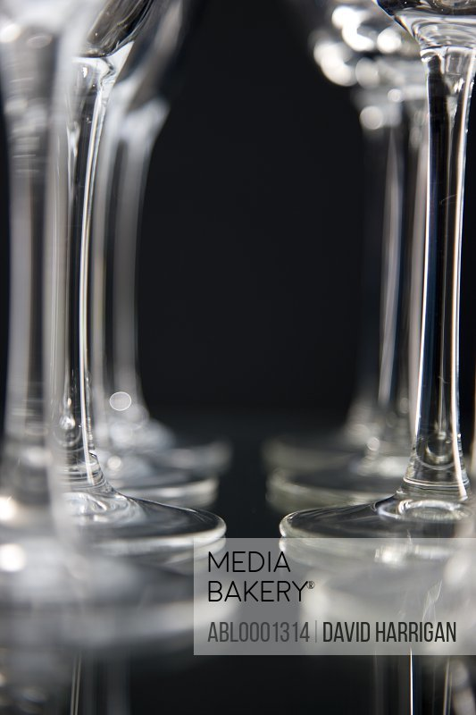 Extreme close up of empty wine glasses lined up