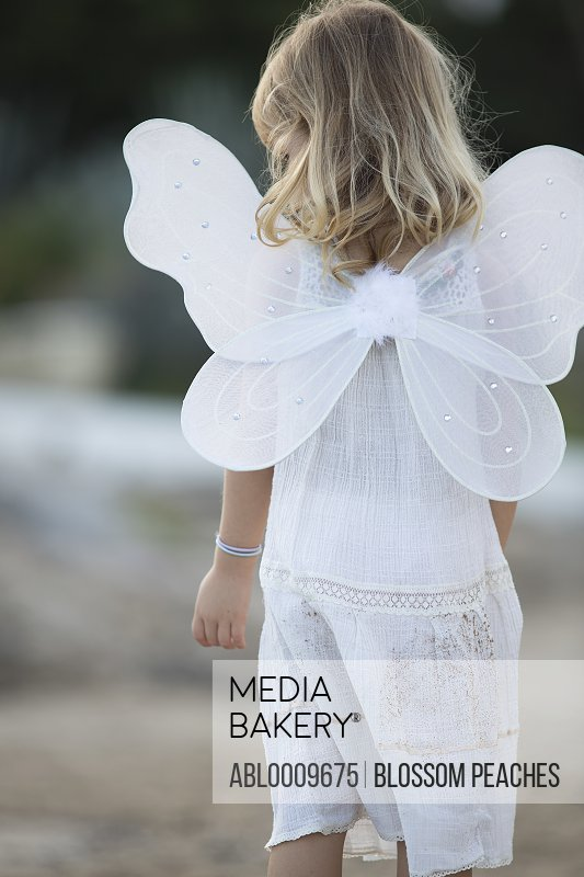 Young Girl Wearing Fairy Costume with Wings, Back View