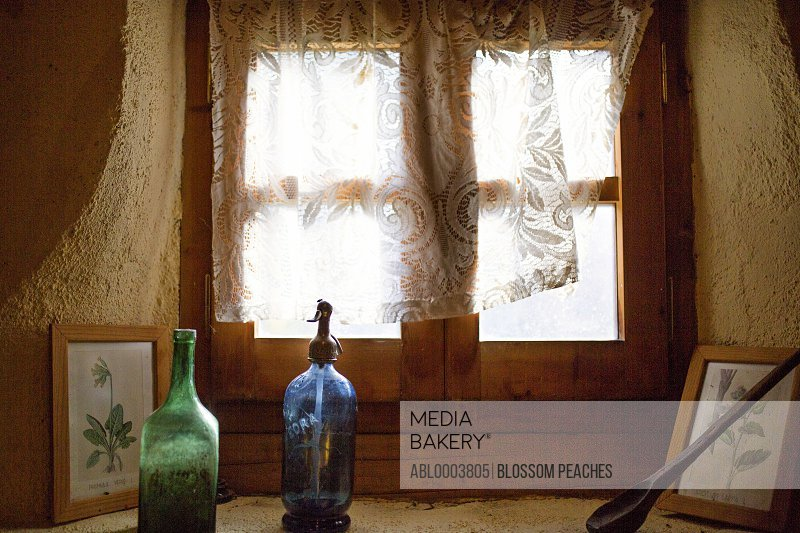 Glass Bottles and Picture Frames on Window Sill