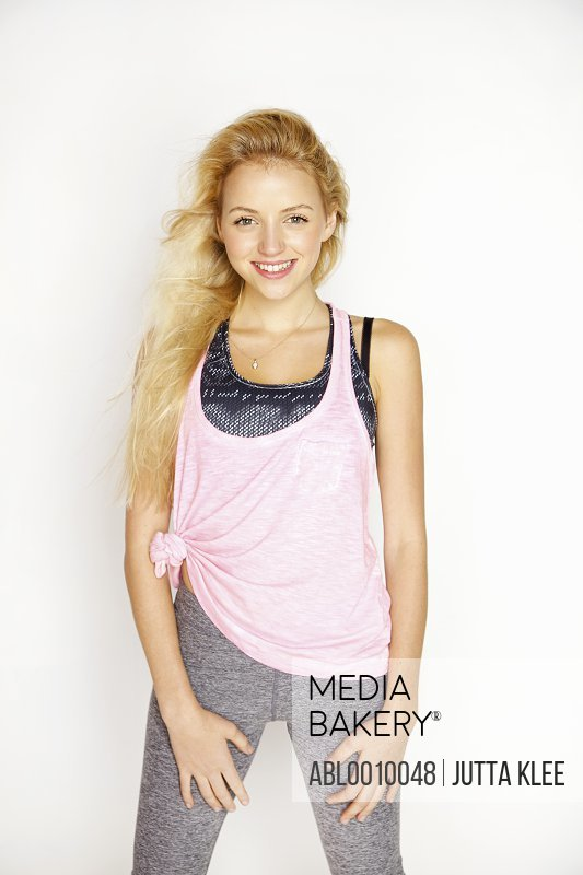 Young Woman in Sportswear Smiling