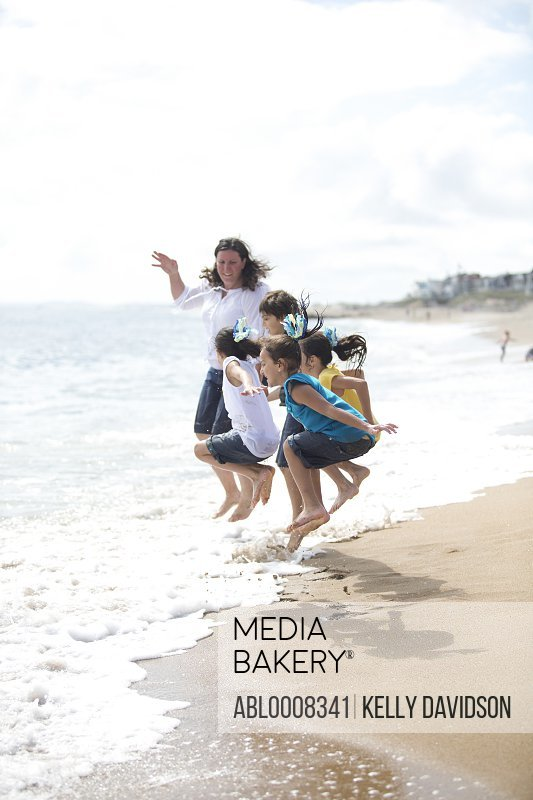 Family Jumping Over Waves