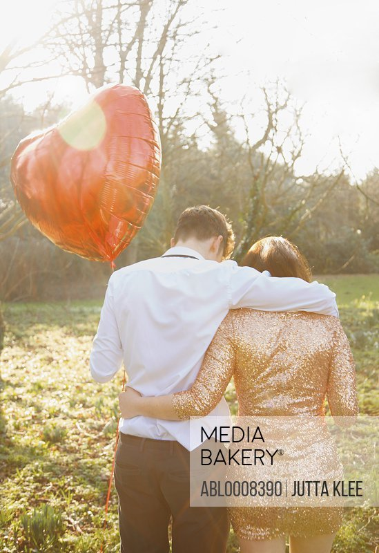 Couple in Park Holding Heart Shaped Balloon, Back View