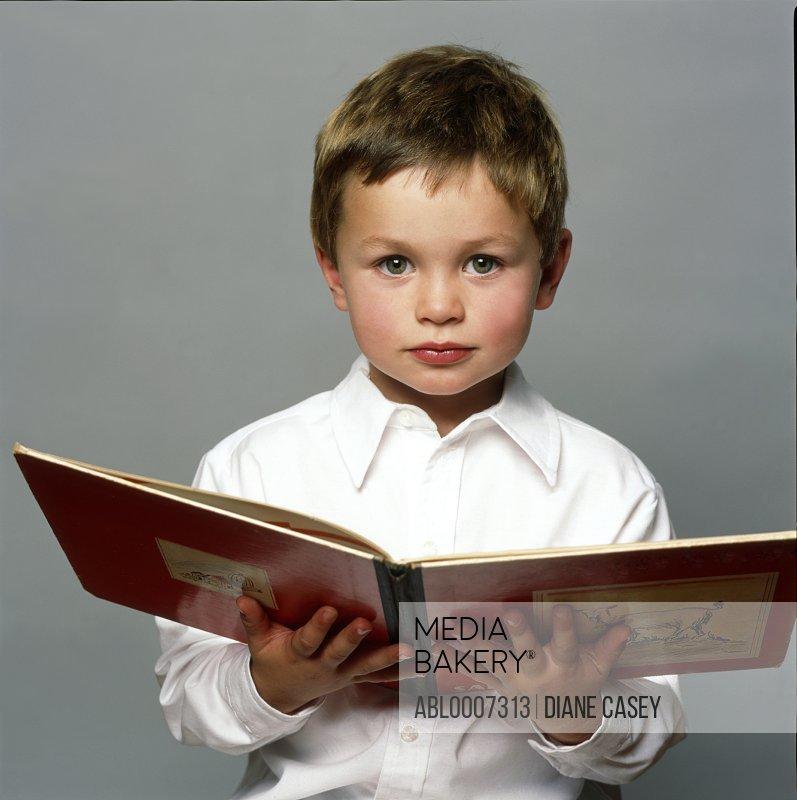 Boy Holding Open Book