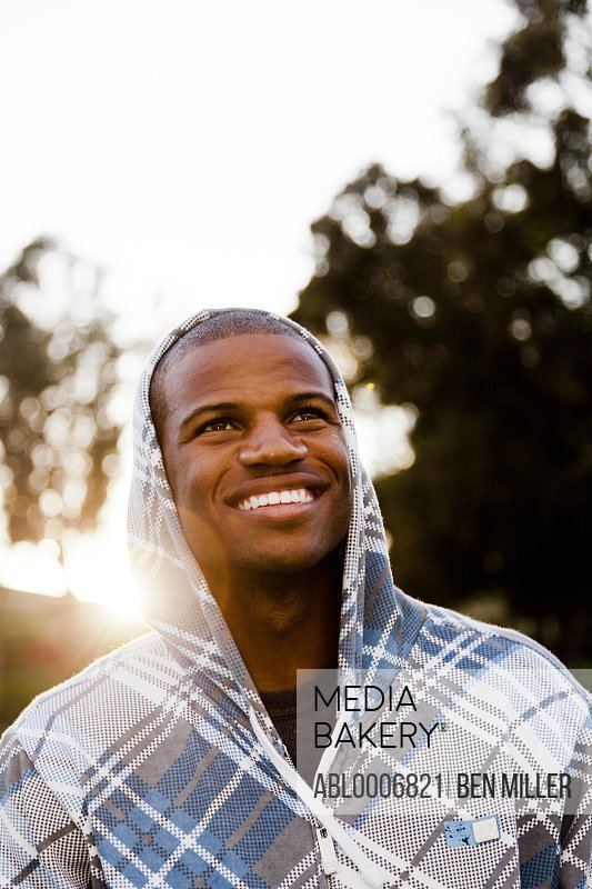 Smiling Man Wearing Hooded Sweater Outdoors
