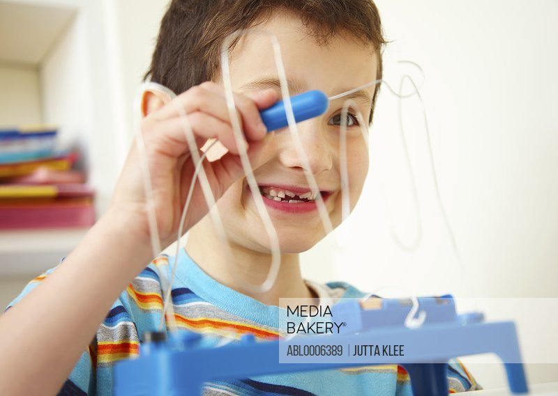 Boy Playing with Wire Coordination Game