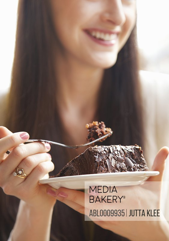 Close up of Woman Eating Chocolate Cake