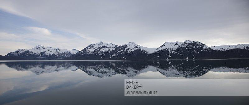 Mountain Range Reflecting on Still Water of Glacier Bay, Alaska, USA