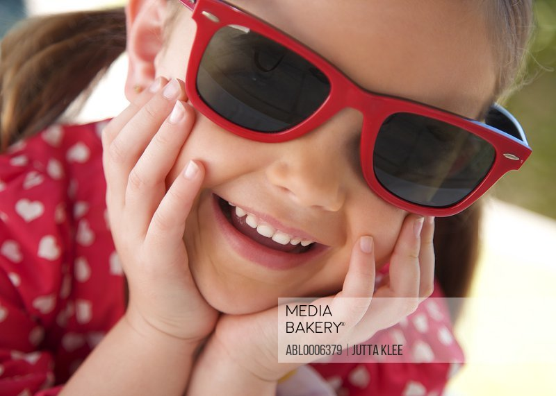 Close up of girl Wearing Red Sunglasses