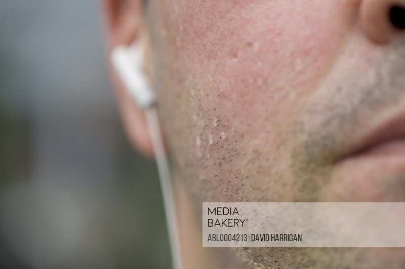 Close up of man's face sweating whilst exercising