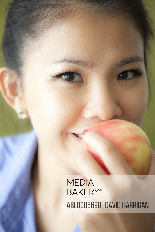 Close up of Woman Eating an Apple