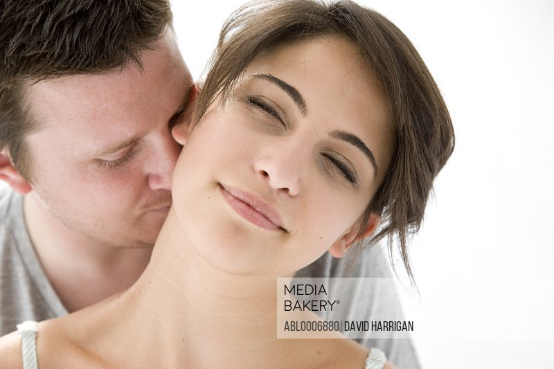 Man Kissing Back of Woman Neck